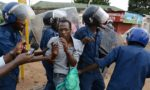 Burundian police detain a protester in Musaga, on the ourskirts of Bujumbura, on April 28, 2015, during a protest against the president's bid to cling to power for a third term. At least five people have died since clashes broke out on April 26 after the ruling CNDD-FDD party, which has been accused of intimidating opponents, designated Nkurunziza its candidate for the presidential election to be held in the central African nation on June 26. AFP PHOTO / SIMON MAINA        (Photo credit should read SIMON MAINA/AFP/Getty Images)