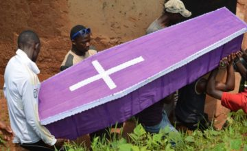 People carry the coffin of a young Burundian opposition party activist named Alexandre Mpawenimana who was allegedly murdered by police in the Muyira district of Bujumbura Province on January 11, 2016.       The small central African country descended into bloodshed in April 2015 when Burundian President Pierre Nkurunziza announced his intention to run for a controversial third term in a July election that he went on to win.  / AFP